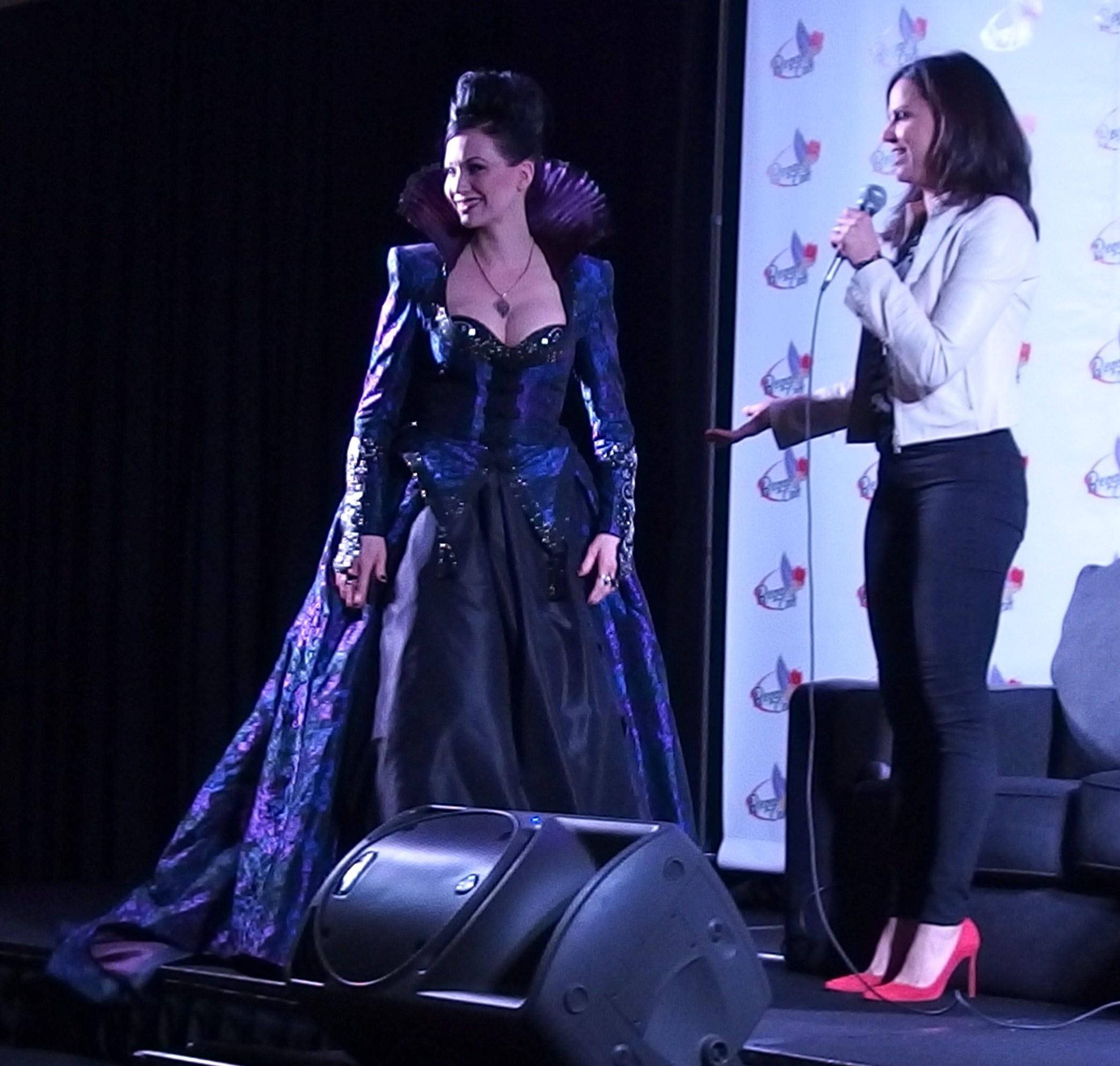 Lana Parilla admires a cosplayer's gown