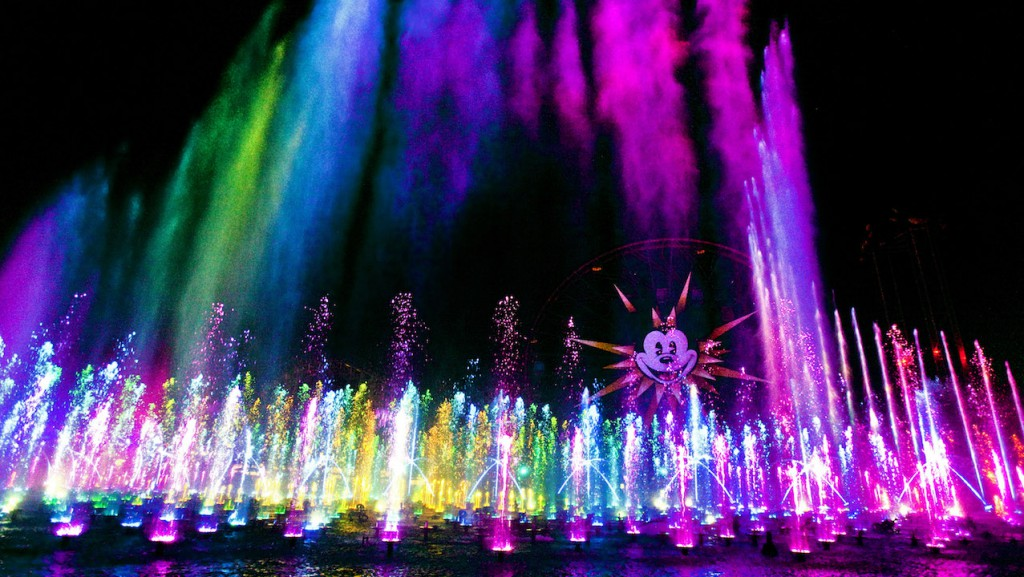"'WORLD OF COLOR' -- Lights, water, music, fire and animation come together like never before in ""World of Color"" at Disney California Adventure park in Anaheim, Calif. The show combines nearly 1,200 powerful fountains with heights that range from 30 feet to 200 feet in the air, dazzling colors and a kaleidoscope of audio and visual effects, including both classic and new animation projected on one of the world's largest projected water screens — a wall of water 380 feet wide by 50 feet high for a projection surface of 19,000 square feet . Presented on Paradise Bay in Disney California Adventure park, ""World of Color"" is a major milestone in the multi-year expansion of the park. (Paul Hiffmeyer/Disneyland)"