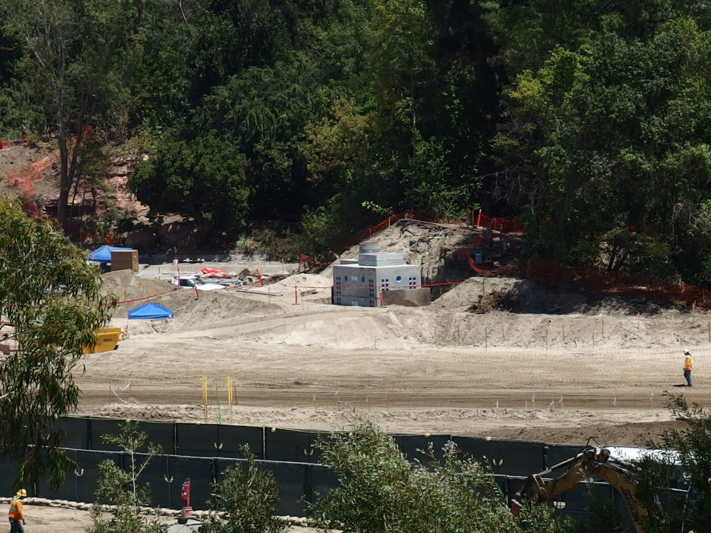 Small concrete structure appears to be a pump vault for a water feature along the re-routed Rivers of America
