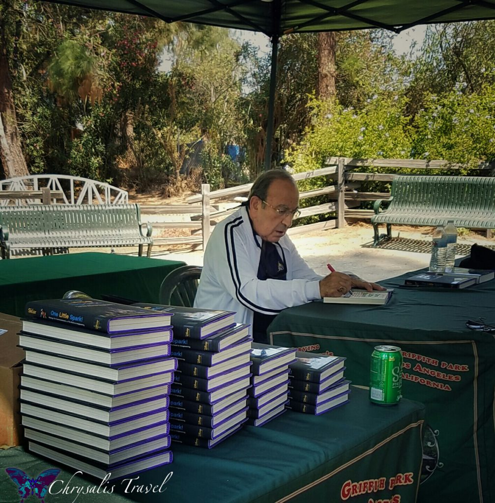 Marty Sklar signing books