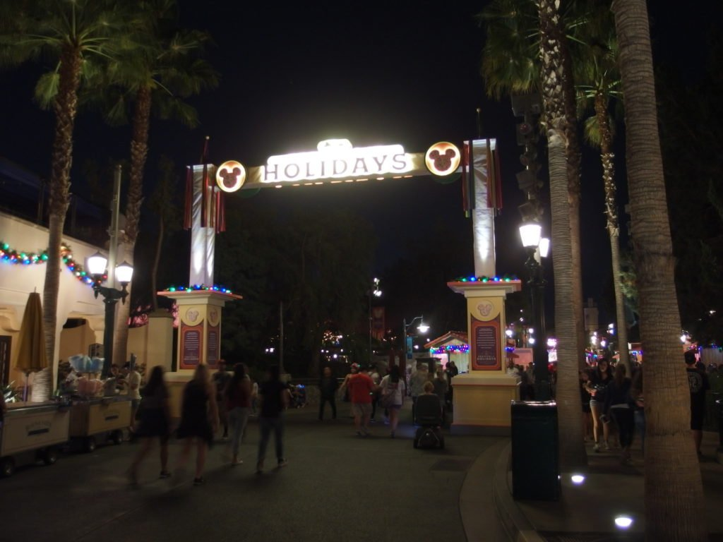 Arched entrance to the Festival of Holiday glows at night