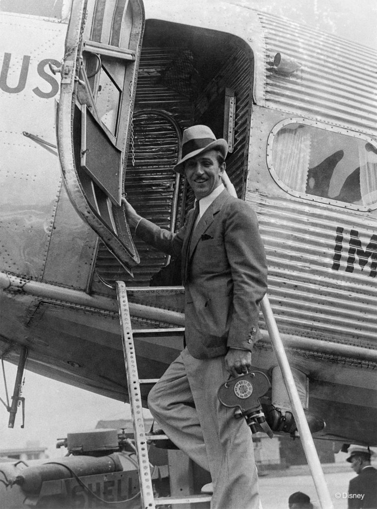 """UP IN THE AIR –– A dapper Walt Disney arrives at Le Bourget airport, near Paris, on June 25, 1935. This photo, along with additional archival images, props, and models, is a part of """"Walt's Great Adventures,"""" an exhibit showcasing Walt Disney's travels and some of his most memorable projects, curated by the Walt Disney Archives exclusively for D23 Destination D: Amazing Adventures. (Disney)"""