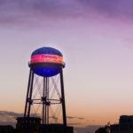 Walt Disney Studios Water Tower Lit Up to Support LA's Olympic Effot