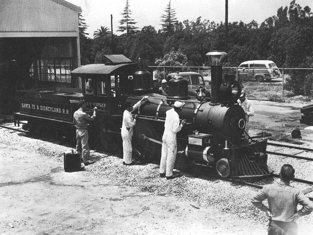 With Winston Road visible through the fence, a crew puts finishing touches on Engine #2, the E.P. Ripley.