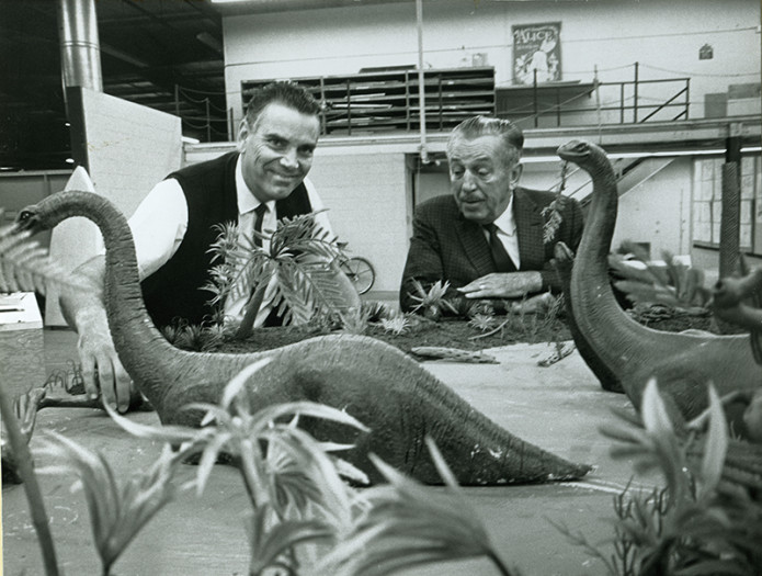(Claude Coats with Walt Disney discussing Primeval World, 1966)