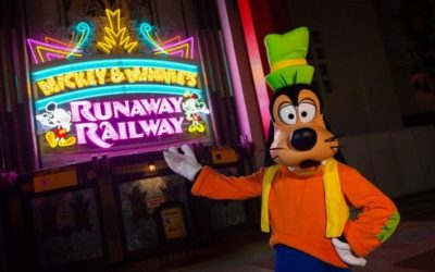Goofy Gives Us Our First Look at the Mickey & Minnie's Runaway Railway Marquee Lit Up at Night