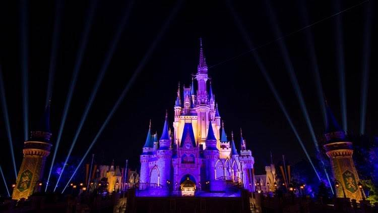 Cinderella Castle Lights Up in Purple and Gold to ...